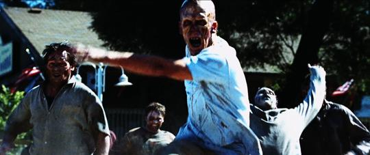 Still from Dawn Of The Dead (2004) of a group of zombies running toward the camera.