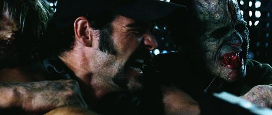 Still from Dawn Of The Dead (2004) of Steve (Ty Burrell) fighting a zombie.