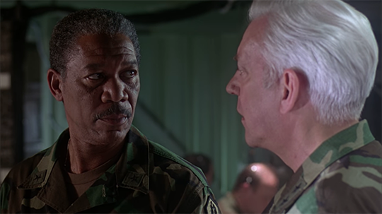 Still from Outbreak (1995) featuring General Billy Ford (Morgan Freeman) and General Donald McClintock (Donald Sutherland)