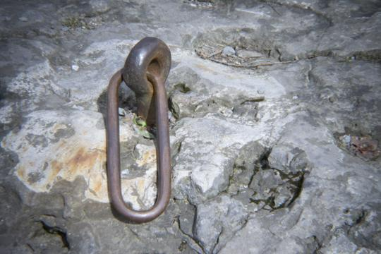 A photograph of some rusty chain link embedded in a large rock. Signs of history at Goat Island and Three Sisters Islands in Niagara Falls State Park by Laura Chenault