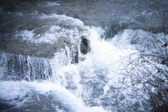 A photograph of rocks and rapids at Goat Island and Three Sisters Islands in Niagara Falls State Park by Laura Chenault