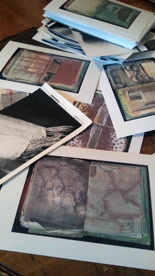 Announcing the Postcard project for Patreon is a photograph of a variety of postcards by Laura Chenault.