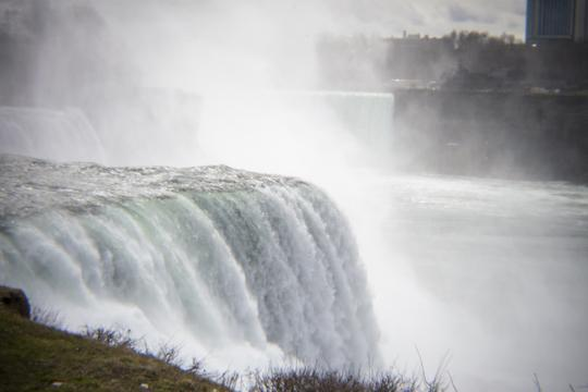 A photo of water flowing over the crest of Niagara Falls by Laura Chenault – Exploring Prospect Point at Niagara Falls State Park