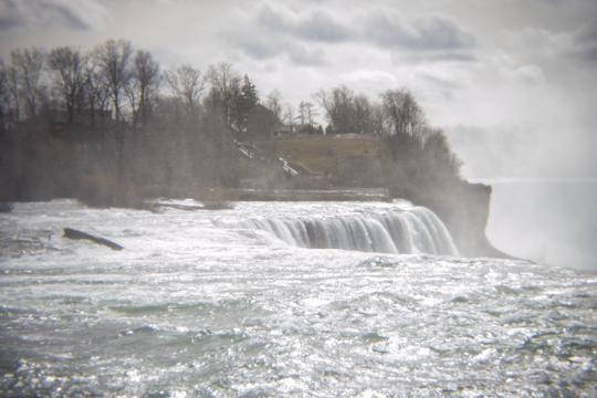 A photo from the top of the falls of water flowing over the crest of Niagara Falls by Laura Chenault – Exploring Prospect Point at Niagara Falls State Park