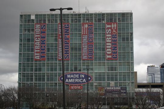 "As seen from the parking lot, a giant glass building with the words ""Made In America"" across the front. Photo by Laura Chenault – Exploring Prospect Point at Niagara Falls State Park"