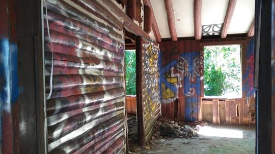A photo of an abandoned log cabin. Exploring an abaondoned cabin in Rancocas State Park by Laura Chenault