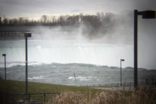 Photo of the horseshoe at Niagara Falls with the empty Niagara State Park in the foreground by Laura Chenault – Exploring Terrapin Point at Niagara Falls State Park