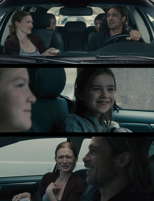 Stills from World War Z: Quarantine Cinema featuring the Lane family in the car. The top image is a shot from the roof of the car of the entire family. The second shot is of the two girls smiling in the back. The third image is the mom laughing at the dad.