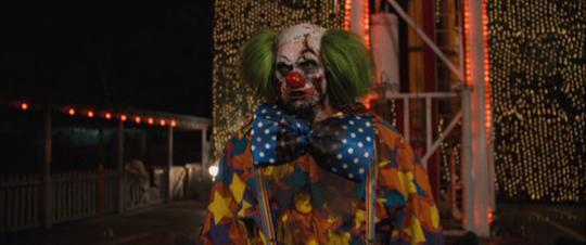 A still from Zombieland (2009): Quarantine Cinema showing a clown zombie.