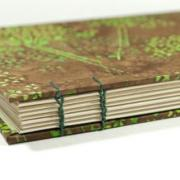 Spine detail of green and brown batik covered journal by Laura Chenault