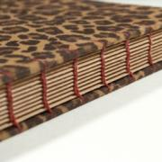 Spine detail of large animal print coptic bound journal by Laura Chenault