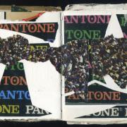 Pantone: Random Journal Page 169 by Laura Chenault has scraps of paper with Pantone written on it in rainbow colors scattered around a white background. Across the spread is an image of a crowd torn into a swath of paper.