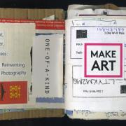 """Make Art: Random Journal Page 174 by Laura Chenault has the words """"Light, Paper, Process; Reinventing Photography"""" on the left side with the phrase """"one-of-a-kind"""" turned 90 degrees. Part of a chopstick wrapper with the kanji for double happiness is on the bottom. The right side says """"make art"""" and is collaged over some Motel 6 wifi passes."""