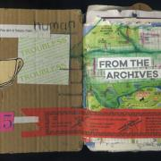 """From the Archives: Random Journal Page 175 by Laura Chenault is a collage inside the fron cover. The left side has a illustration of a fortune cookie, a fortune that says """"you are a happy man"""" with the word """"human stenciled over it, and the year """"2015"""". The right hand side has the words """"from the archives of"""" collaged over a map of Golden Gate Park. Instructions on how to use chopsticks span the bottom."""