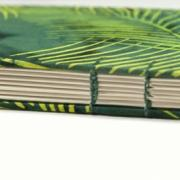 Spine detail of small green batik coptic bound journal by Laura Chenault