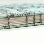 Spine detail of small toile coptic bound journal by Laura Chenault