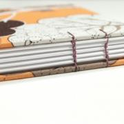 Spine detail of Small retro trees coptic bound journal by Laura Chenault